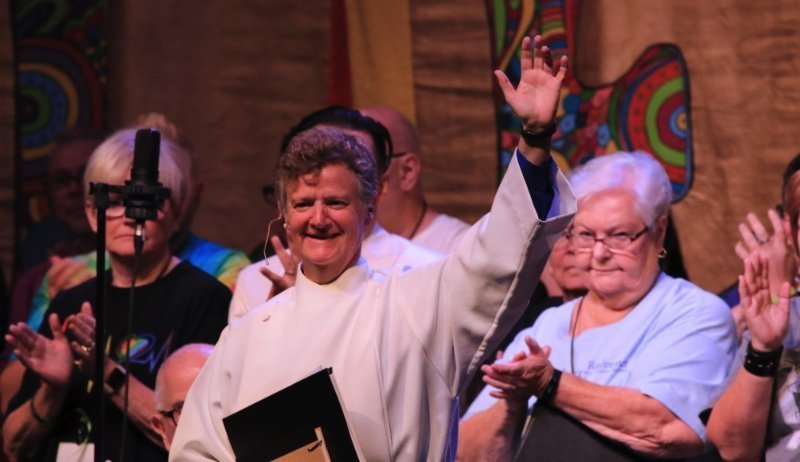 Rev. Elder Cecilia Eggleston (center) waves to the crowd attending General Conference on the day of her installation as Moderator on 5 July 2019. (photo by Jeff Henderson)